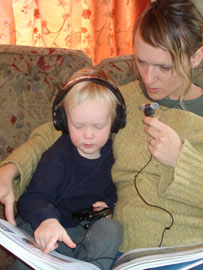 mother reading to son using audio amplifier